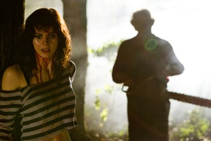 Heather (Alexandra Daddario) is menaced by Leatherface (Dan Yeager)
